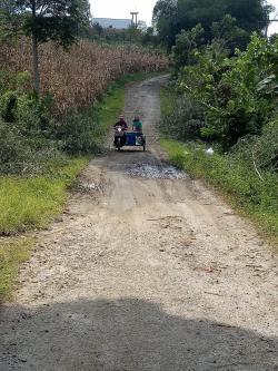 Jalan Desa Batu Mamak Juhar Rusak Butuh Perbaikan