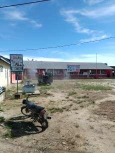 Pemerintah Nagori Diparhataran Simalungun Semprot Disinfektan Jalan dan Fasilitas Umum